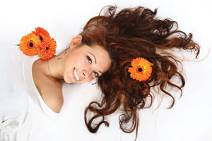 Brunette Girl with flowers in her hair.